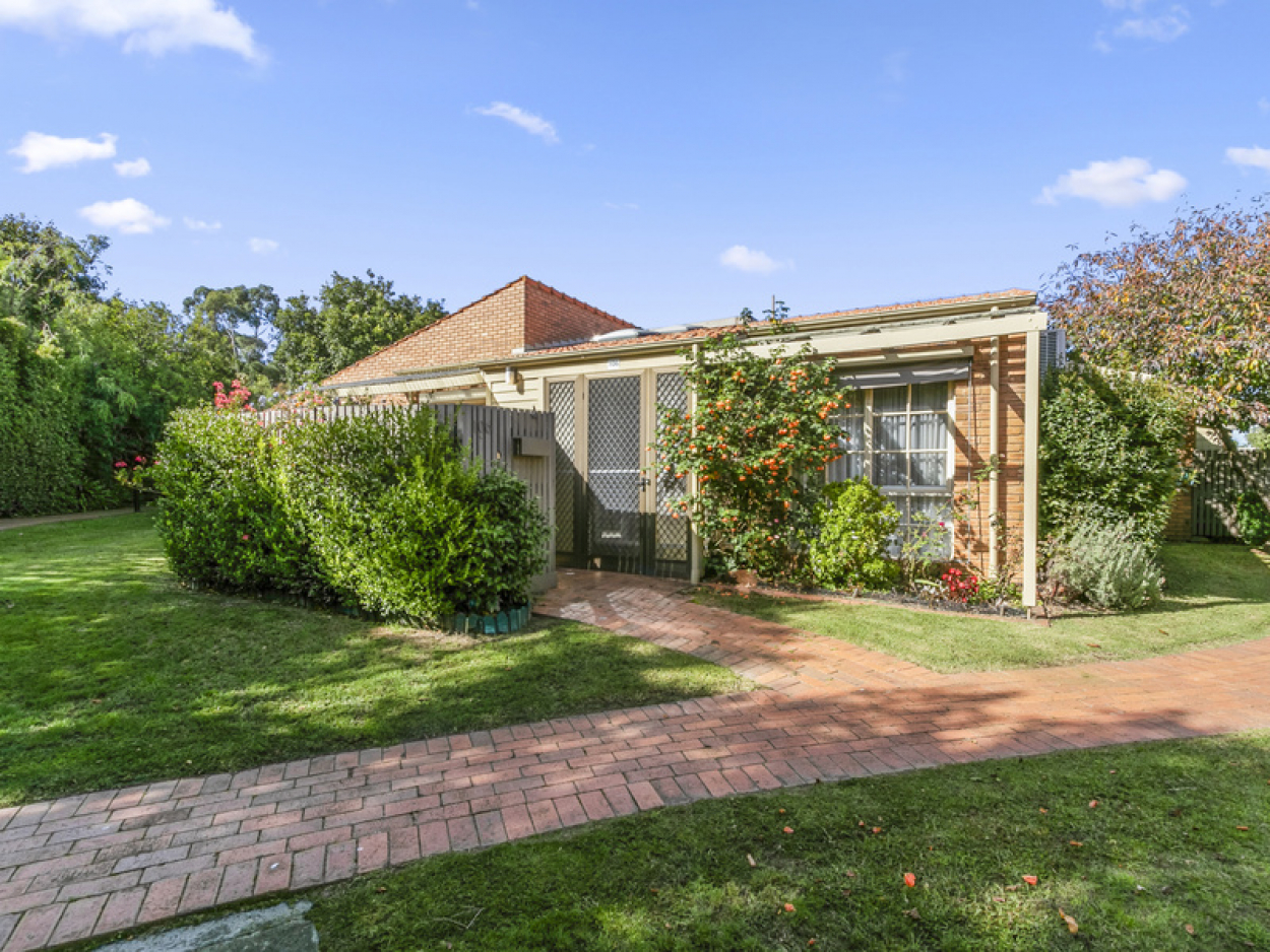 Positioned in a beautifully quiet and well manicured garden setting