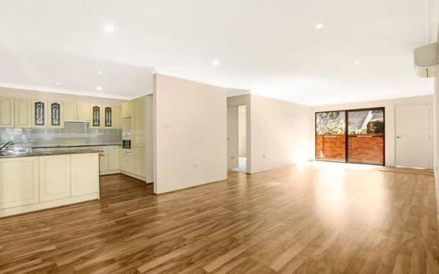 Spacious home with polished floors in living space and private outdoor entertaining area