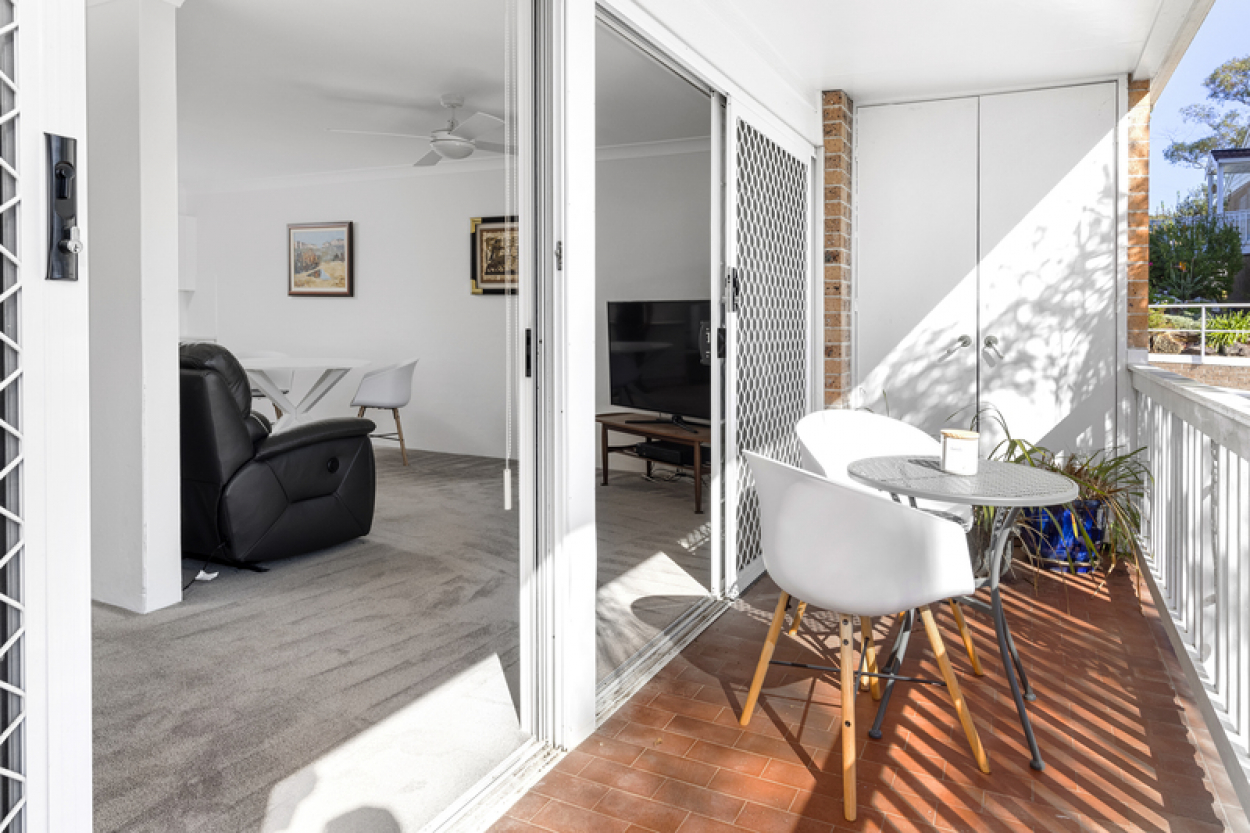Stylish serviced apartment at club house level with balcony overlooking gardens.