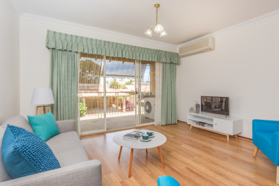 Relax and enjoy the large balcony and watch the world go by in this popular upper floor two bedroom villa