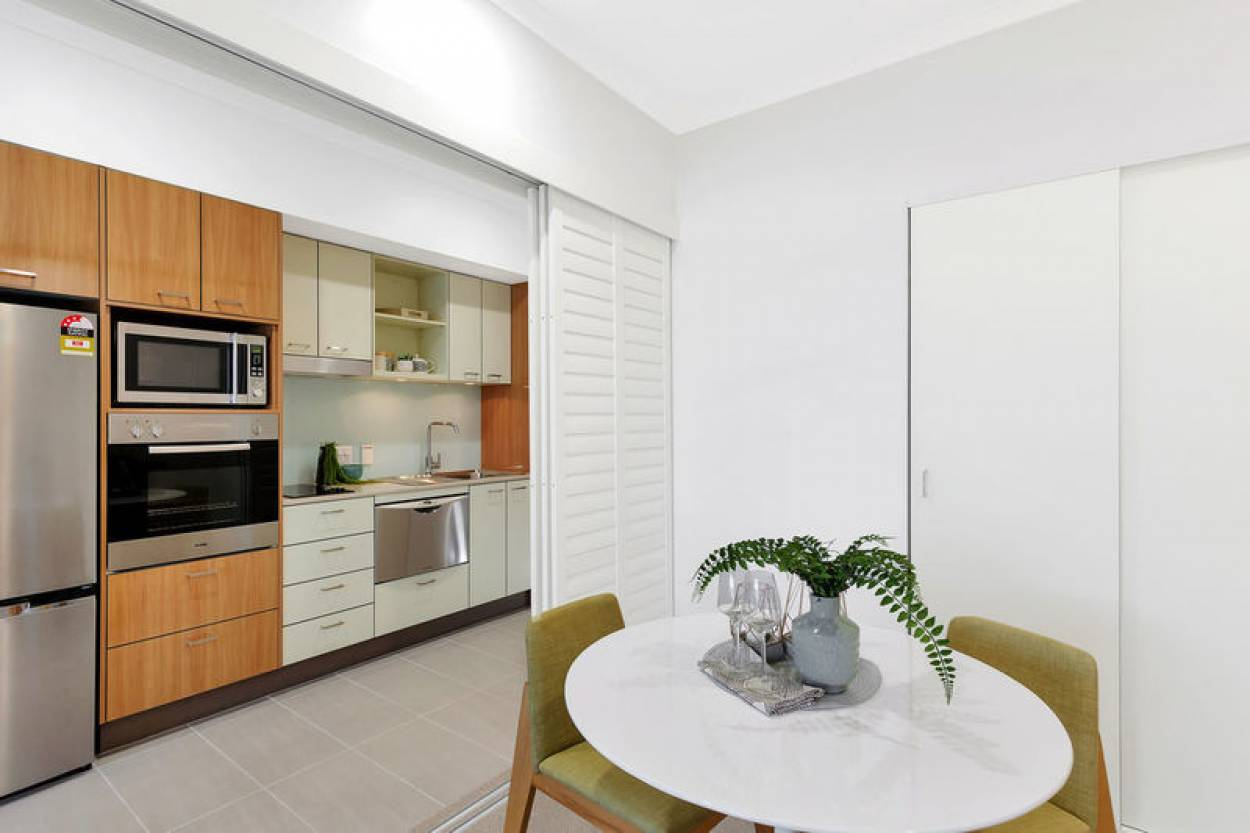 Open plan unit with private balcony featuring district views
