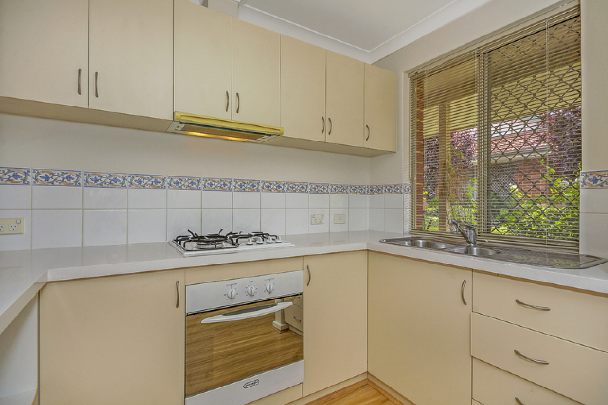 Lovely location, new flooring and blinds.