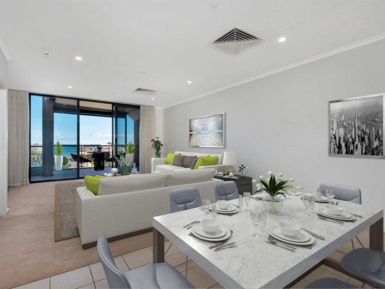 Delightfully spacious three-bedroom penthouse perched on the second floor with ocean views offering a luxurious and easy lifestyle
