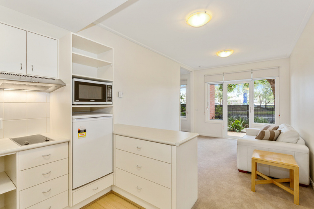 Spacious ground floor apartment with private outdoor terrace.