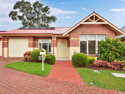 Charming home nestled in a quiet gated area of this lifestyle village