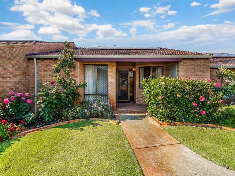 Well-presented cottage style home, lovingly cared for by vendor, set amongst manicured gardens.