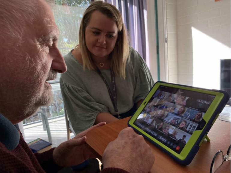 Aged care resident Lyell Burrow takes part in the virtual intergenerational playgroup initiative