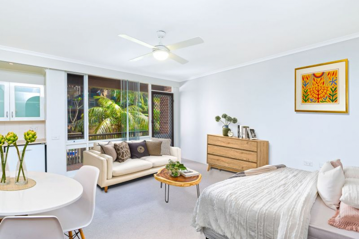 Secure, serviced studio apartment offers sunny balcony and palm-fringed outlook