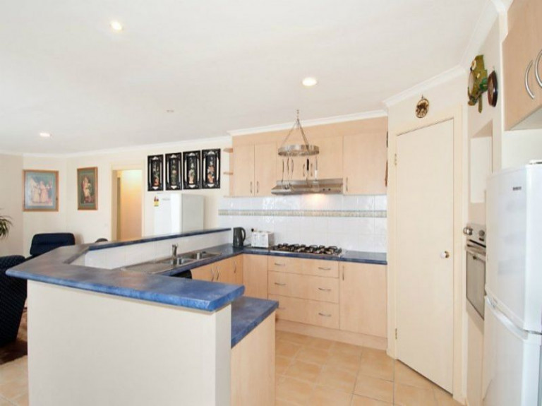 FOUR BEDROOMS, TWO LIVING, DECKED OUTDOOR AREA, GREAT LOCATION!
