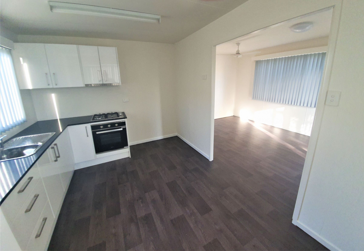 PRICE SLASHED $24K, RENOVATED PAD WITH 2 STREET FRONTAGE, NEW KITCHEN, A/C etc.