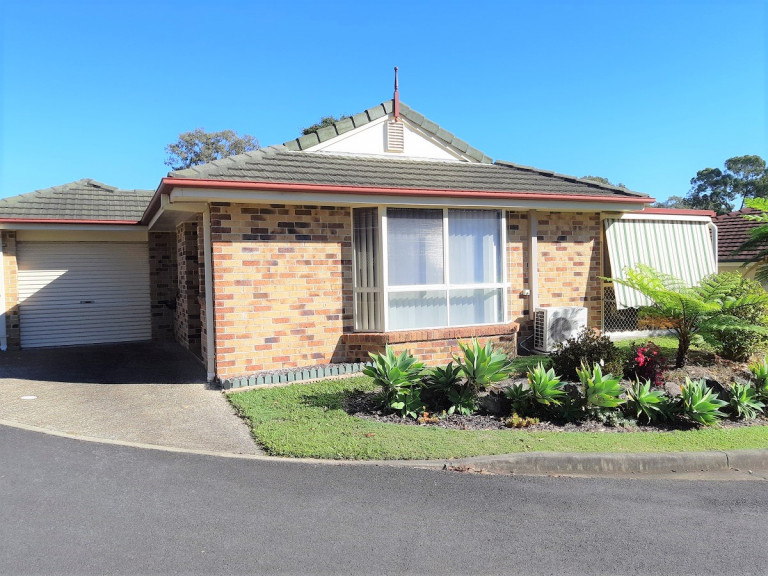 Spacious 2 bedroom 1.5 bathroom Villa recently renovated with lock-up garage, courtyard and sunroom.