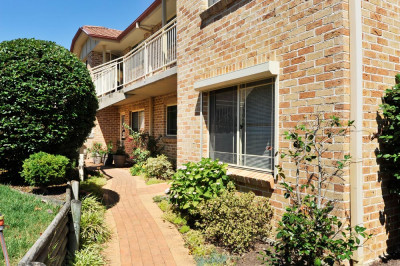 Unique Offering– A Ground Floor Unit With TWO Garages!
