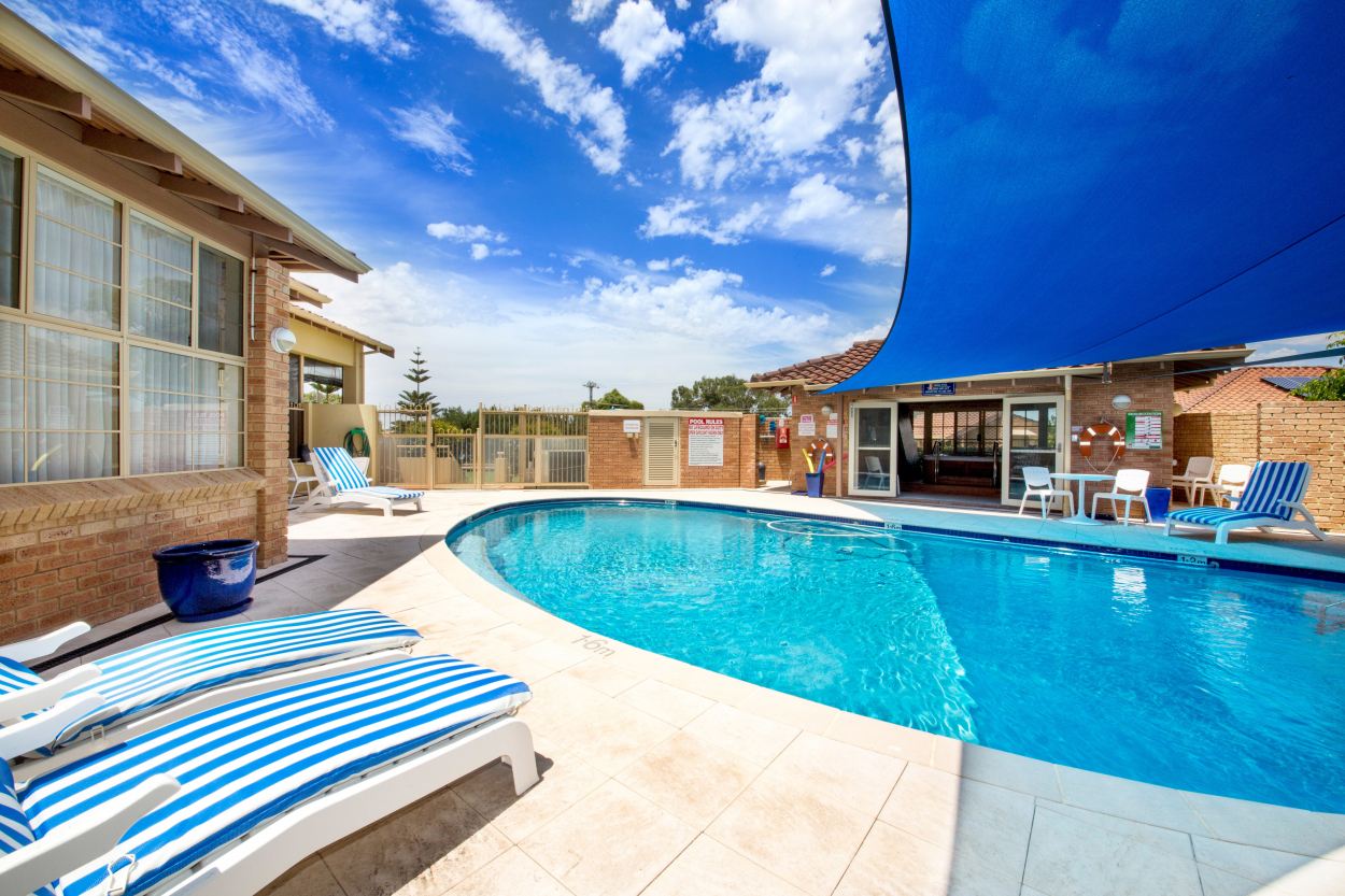 Tucked away with lovely outdoor areas back and front. Price Reduced!