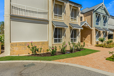 New to the market! Superbly presented lower level two-bedroom apartment in resort style village – Ready to move into now!