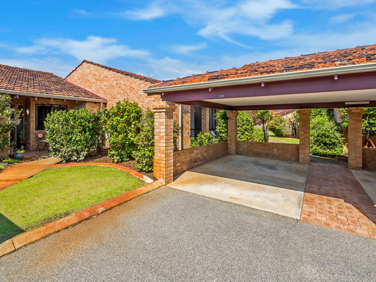 Freshly updated home with appealing, flexible floorplan, situated in a lovely garden setting