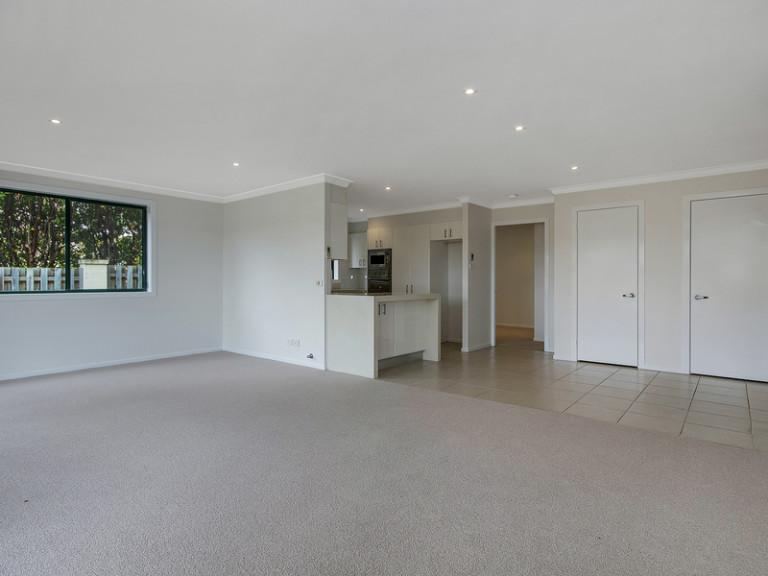 Enjoy an elevated private position in this refurbished two-bedroom unit that is within an easy stroll of the vibrant community centre