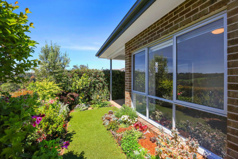 Retire in style in this lovely home with beautiful views