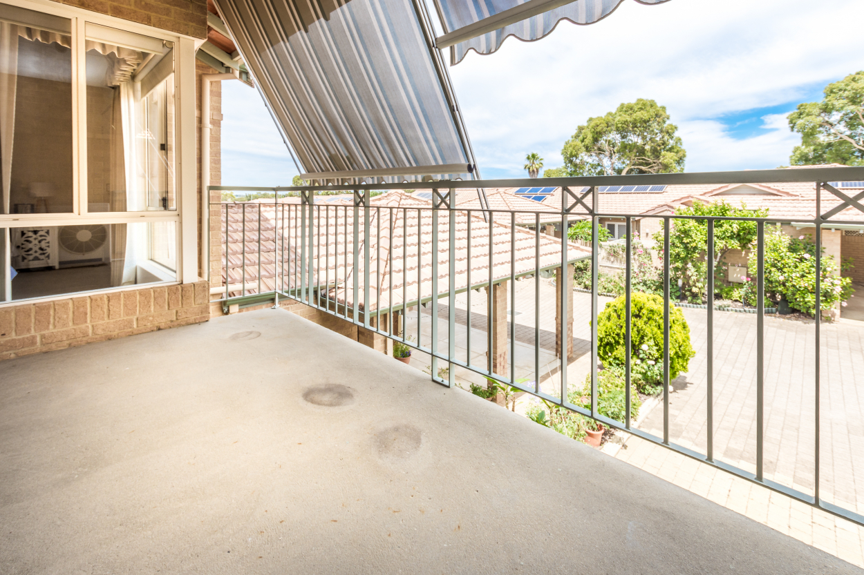 Relax and enjoy the large balcony and watch the world go by in this popular upper floor villa