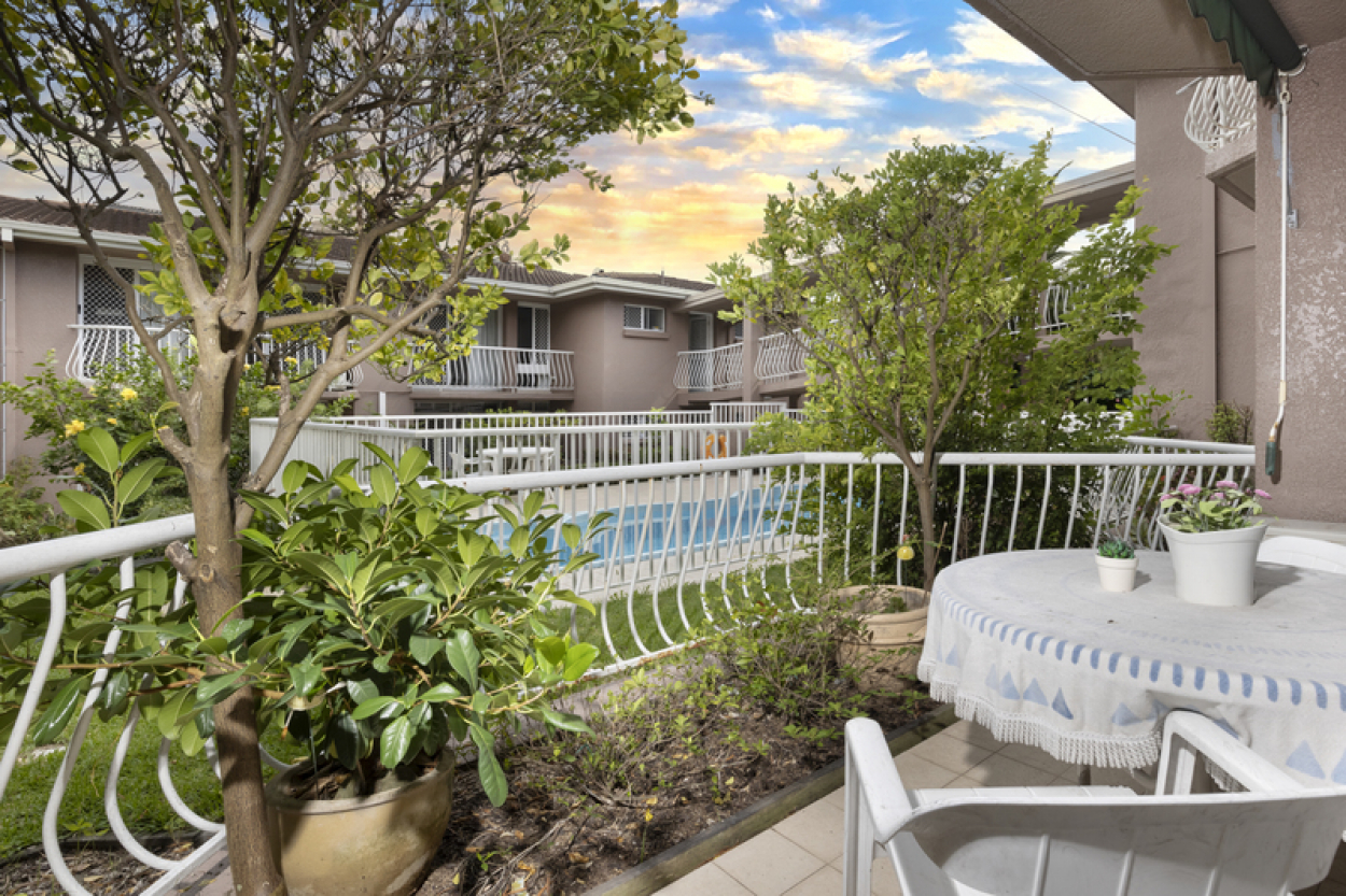 Sunny ground floor care apartment with garden and pool views.