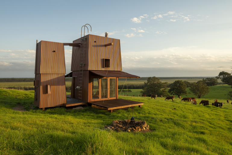 The Permanent Camping Two home design blends into its rural landscape location