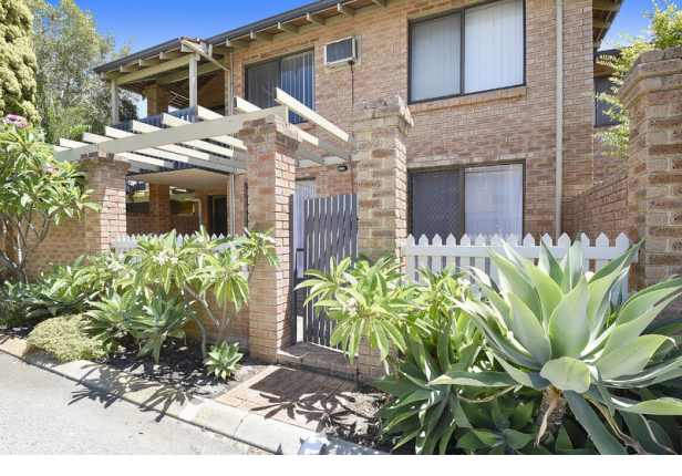 Newly painted two-bedroom villa offers open plan living with vinyl wood flooring throughout.