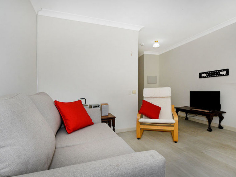 Light and bright, upper level apartment, securely situated within the stunning clubhouse