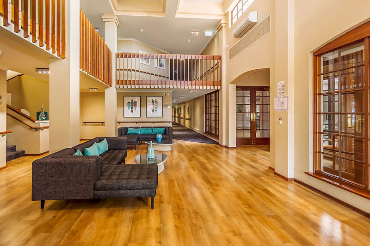 Modern living with timber floors and stone benchtops.