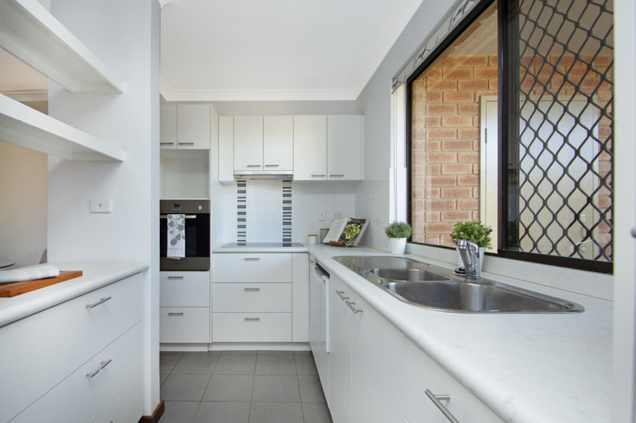 Newly painted villa offers open plan living with vinyl wood flooring throughout.